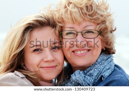 Mother and daughter on a winter beach