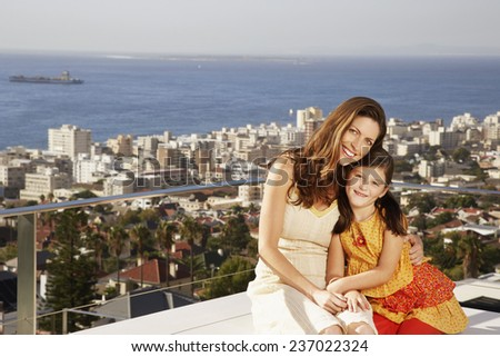 Mother and Daughter on Balcony - stock photo