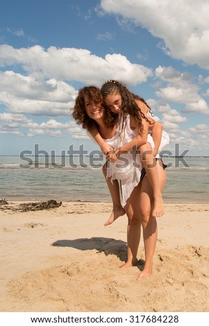 Mother and daughter  on holidays having fun