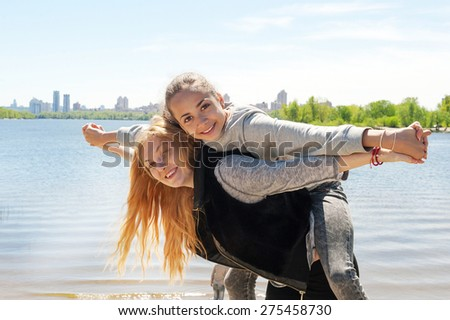 Mother and daughter on the background of the lake - stock photo
