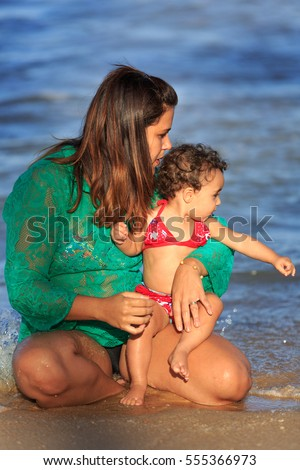 Mother and daughter on the beach