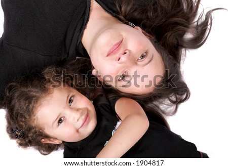 mother and daughter on the floor over white