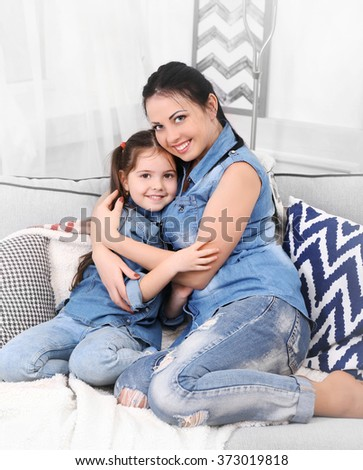 Mother and daughter on the sofa