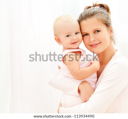 Mother and daughter play in the bedroom - stock photo