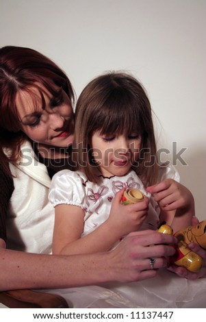 mother and daughter Playing with dolls together