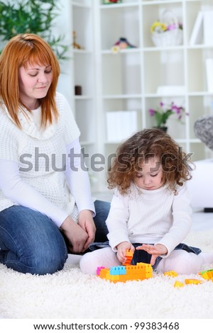 mother  and daughter playing with toys together
