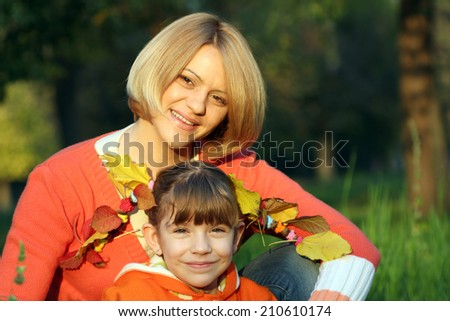 mother and daughter portrait autumn season