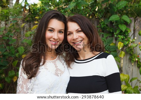 Mother and daughter portrait in a outdoor setting. - stock photo