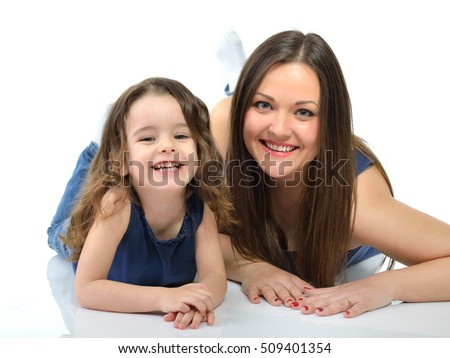 Mother and daughter. Portrait of little girl with her mother over white background.