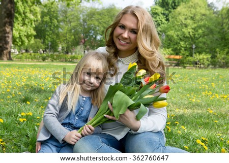 Mother and daughter portrait with flower