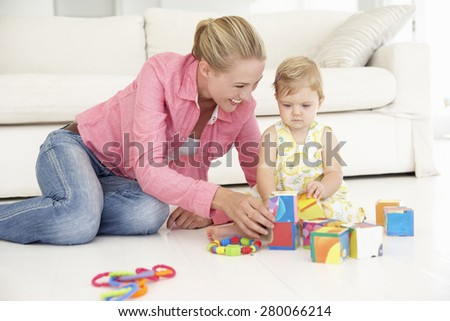 Mother and Daughter Pplaying Together At Home - stock photo