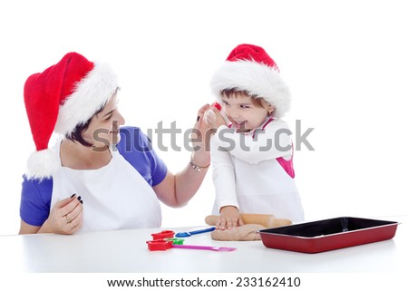 Mother and daughter preparing cookies for christmas - stock photo