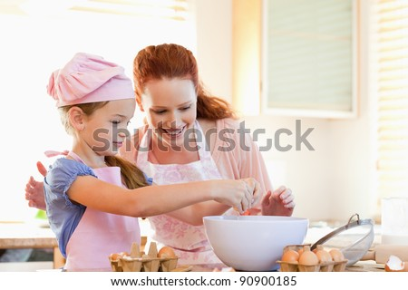 Mother and daughter preparing cookies together