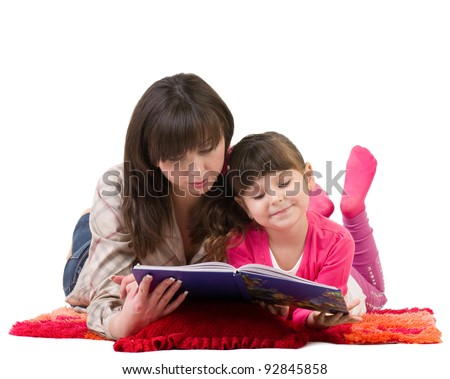 Mother and daughter reading a book on white background. - stock photo
