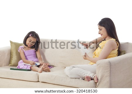Mother and daughter relaxing - stock photo