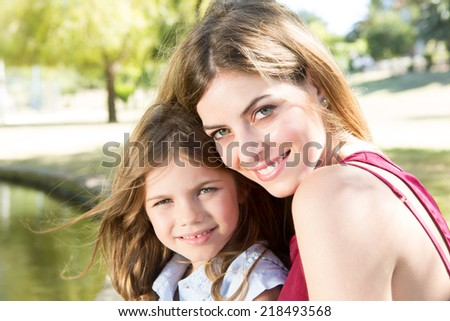 Mother and daughter relaxing in the city park