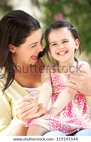 Mother And Daughter Relaxing On Sofa Together - stock photo