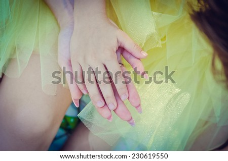 Mother and daughter's hand in hand - stock photo