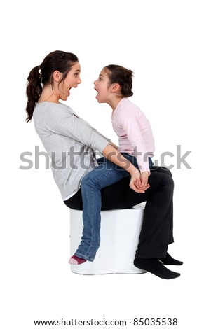 Mother and daughter shouting at each other - stock photo