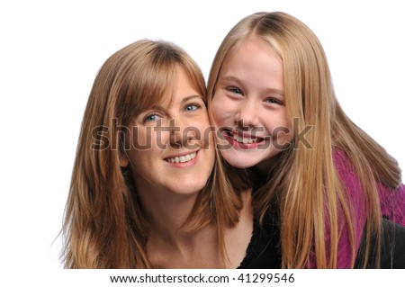Mother and daughter smiling isolated on a white background