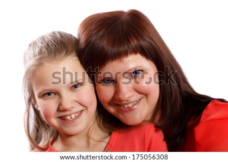 Mother and daughter smiling on a white background