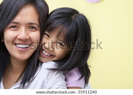 mother and daughter spending time together - stock photo