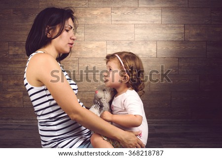 mother and daughter talking to each other