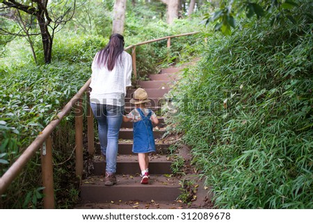 Mother and daughter to climb the stairs