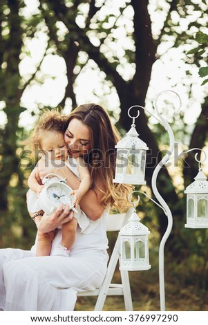 mother and daughter together in garden outdoors - stock photo