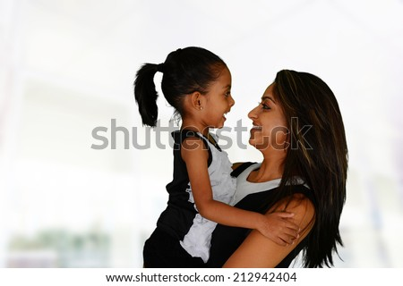 Mother and daughter together inside of their home - stock photo