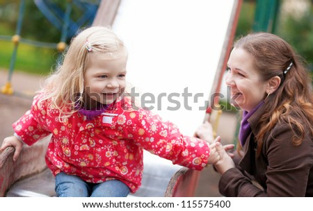 Mother and daughter together on playground