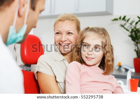 Mother and daughter visiting the dentist.