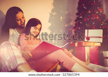 Mother and daughter waiting for santa claus at home in the living room - stock photo