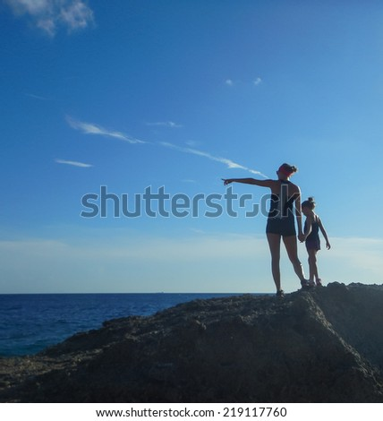 mother and daughter walking  at Jan Theil Beach on Curacao a Caribbean Island in the Dutch Antilles