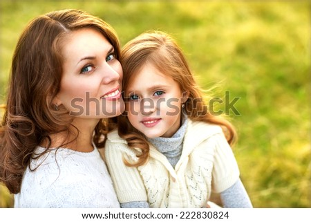 mother and daughter walking in summer in a field, mother's Day. - stock photo