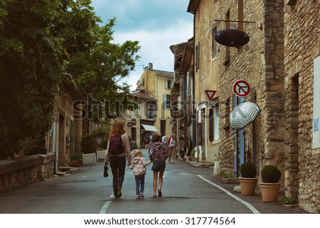 mother and daughter walking through the streets Gorda in Provence, France