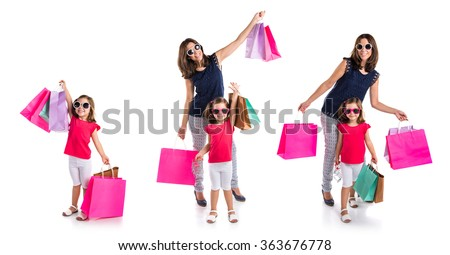 Mother and daughter with many shopping bags