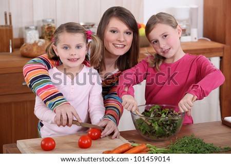 mother and daughters cooking together