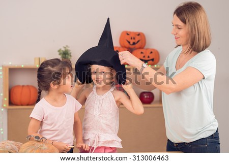 Mother and daughters preparing for Halloween party