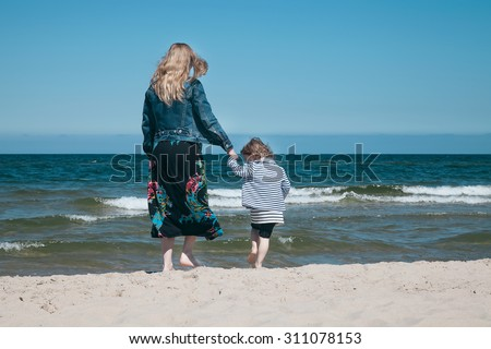 Mother and daugter at the seaside