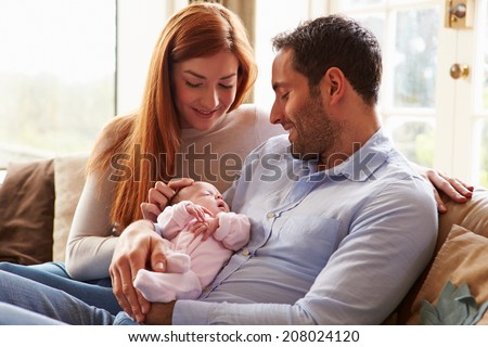 Mother And Father At Home With Newborn Baby - stock photo