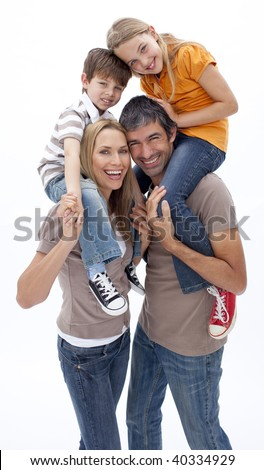 Mother and father giving children piggy back ride against white background - stock photo
