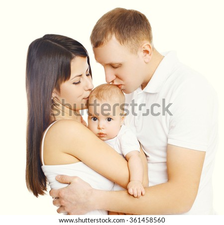 Mother and father kissing baby, happy family on a white background - stock photo