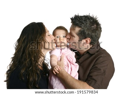 Mother and father kissing cute baby girl - stock photo