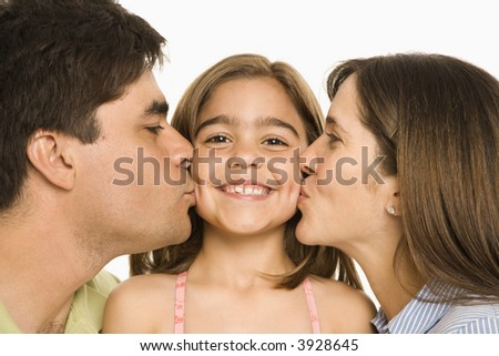 Mother and father kissing smiling daughter   on opposite cheeks. - stock photo