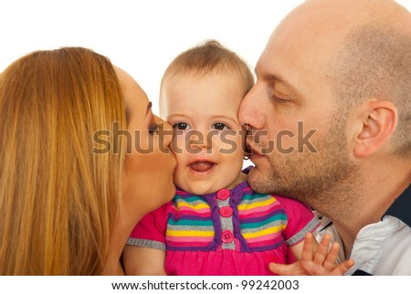 Mother and father kissing together thier baby girl isolated on white background