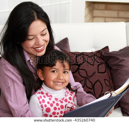 Mother and girl smiling in the home