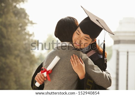 Mother and Graduate Hug - stock photo