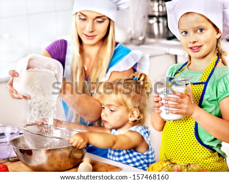 Mother and granddaughter baking cookies.