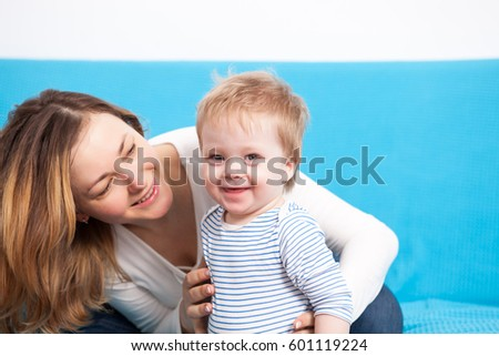Mother and happy child having fun time together. Family lifestyle